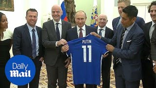 Vladimir Putin meets with FIFA President and Rio Ferdinand - Daily Mail