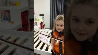 My friend sophie playing my violin