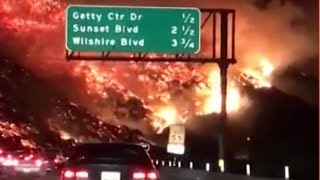 Commuter drives through raging wildfire in California – dashcam video