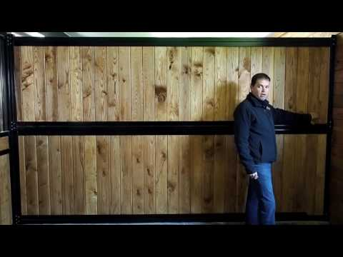 man standing in horse stall