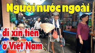 Người nước ngoài cụt chân chống nạng sang Sài Gòn xin tiền kiếm sống