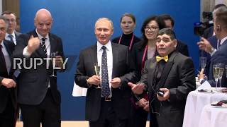 Putin's toast with football legends ahead of World Cup draw