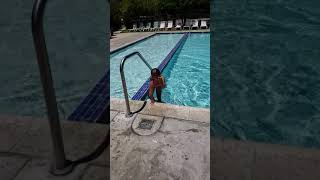 Jenny jumping in to the pool