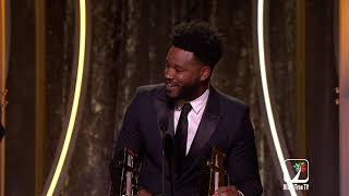 Ryan Coogler receives an award for Black Panther at the Hollywood Film Awards