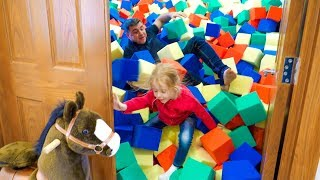 Stacy and dad pretend play at the funny house