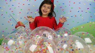 Лопаем воздушные Шарики с конфети Веселый фейерверк из цветной бумаги!