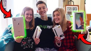 SURPRISING MY LITTLE SISTERS W/ NEW IPHONES! (Super CUTE Reaction)