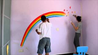 Rainbow paint on wall for Chloe's room