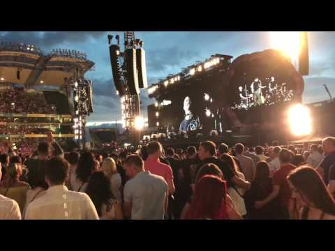 Beer bottle strikes Coldplay guitarist in the head. Chris Martin almost cancels show. 2017 USA