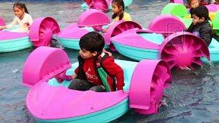 Happy boat rides for children at Surajkund Mela, India