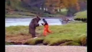 Fisherman takes on bear