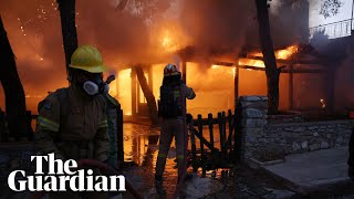 Greece: Wildfires reach outskirts of Athens forcing thousands of residents to flee
