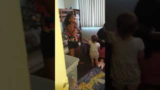 A little kid doing just dance