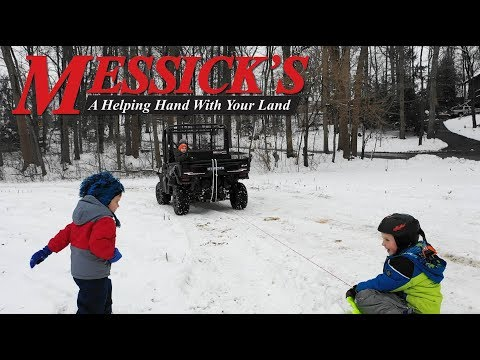 Sledding behind the Kubota RTV-XG850 SideKick Side-By-Side Picture
