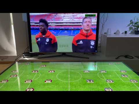 Sportcaster is a media application designed to augment and enhance the sports viewing experience of a Champions League football (soccer) game. The primary screen, where the game is shown, is the TV that can display up to four matches in parallel. Mimicking the stadium videoboards, SurroundWall features UIs that present live information that varies depending on the context. In more details, before the beginning of the match, viewers can see the lineups, last matches form and Head-to-head statistics, while during the match the default displayed information includes live game details (e.g., score, time), player statistics (e.g., goals scored, cards), and social media feed. On key moments, such as penalties or free-kicks, SurroundWall is used to display complementary videos (e.g., a replay) or ask for user input (e.g., a poll regarding the VAR decision).