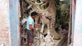 cement sculpting, durga murti making, contemporary cement