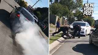Reckless driver does burnouts right in front of cops