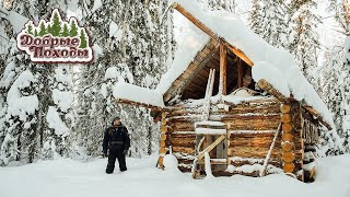 Life in a log cabin. Making a window in a log cabin. Russia. Taiga.