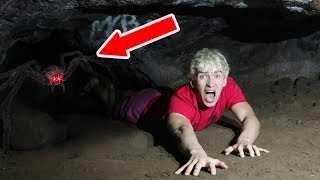 EXPLORING ABANDONED SPIDER CAVE!! (HAUNTED)