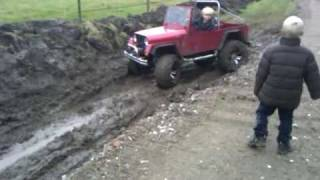Two Kids drive a 1/2 size Jeep through mud