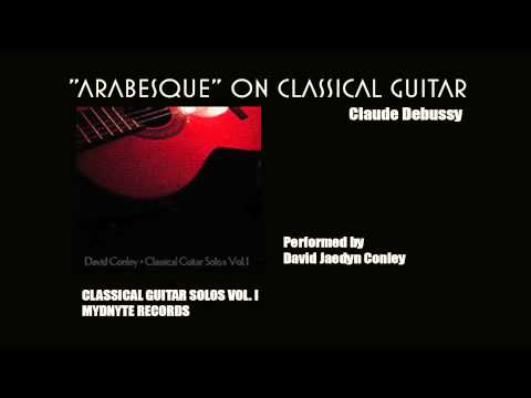 "The instructor performing Claude Debussy's ""Arabesque"" on classical guitar."