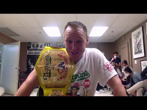 Joey Chestnut Breaks Record Putting Away 75 Hot Dogs In Nathan's Famous Hot Dog Eating Contest