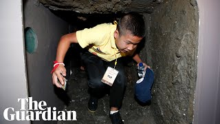 Thai boys trapped in cave climb through replica