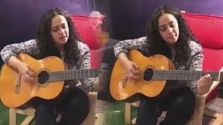 Watch: Nithya Menon superbly singing and playing Guitar..