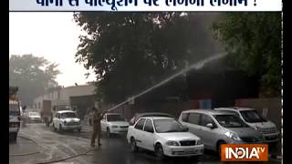 Fire services sprinkle water on trees near Delhi Secretariat due to rising air pollution