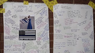 Mourners create a memorial for fallen officer Natalie Corona