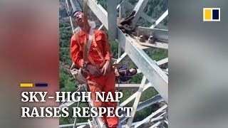 Chinese workers nap 50 metres above ground on transmission tower