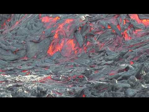 Red hot lava battles snow as volcano erupts