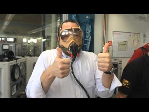 Trying on an oxygen mask at Lufthansa Technik in Hamburg