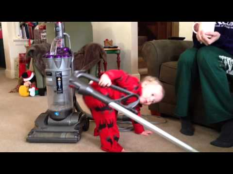 Brady vacuuming at 18 months