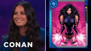 """How Olivia Munn Squeezes Into Her """"X-Men"""" Costume  - CONAN on TBS"""