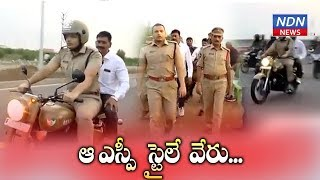 Prakasam SP rides on bike, interacts with people walking o..
