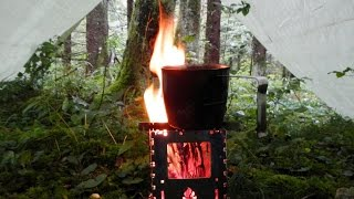 """Tarp setup with """"Chimney"""" and Fire inside"""