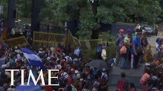 Migrants Break Through Fence At Guatemala Border | TIME