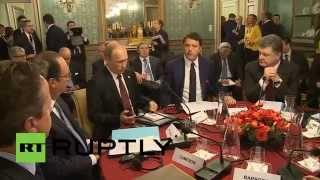Порошенко и Путин обменялись рукопожатием в Милане