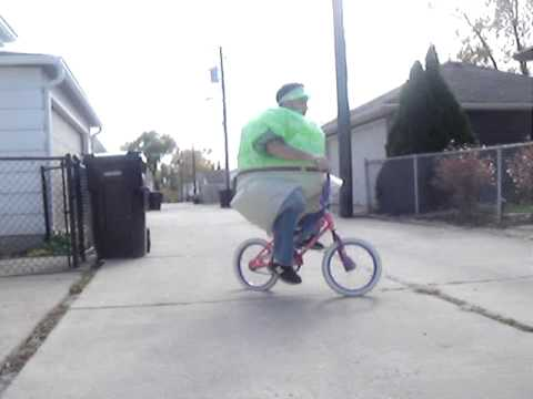 Fat Man On Bicycle 102