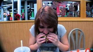 Tiny girl eats Big Mac in 1 minute