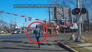 Exclusive: Man Saves Senior from Oncoming Train!