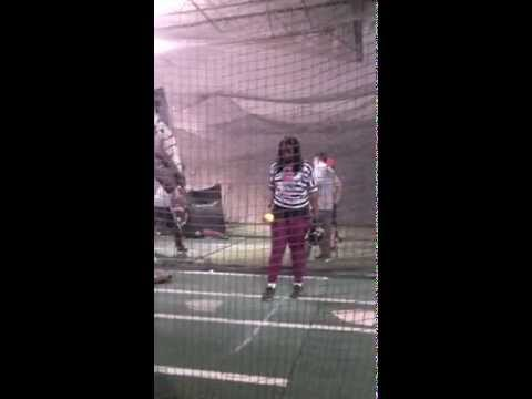 Softball player learning pitching steps