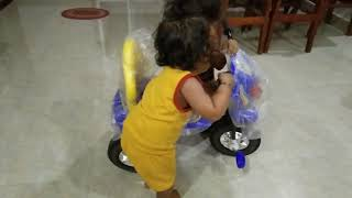 Little baby enjoying new bicycle/ little girl dancing on Eya eya yo poem