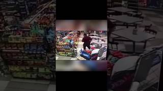 Man walks pass guy robbing a Store with gun in his face like nothing happened