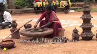 Woman potter works her wheel in Karnataka