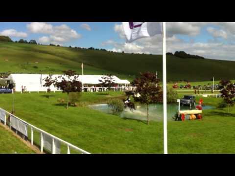 Allison Springer & Arthur jump through the main arena at Barbury