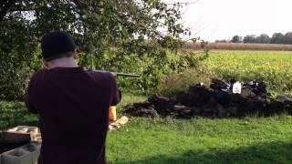 Eric shoots a gun in slo-mo