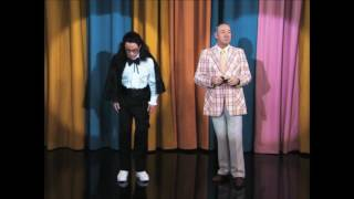 Kevin Spacey impersonating Johnny Carson shoots Jimmy Kimmel with a crossbow