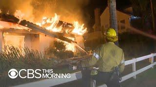 Deadly and destructive wildfires tear across California
